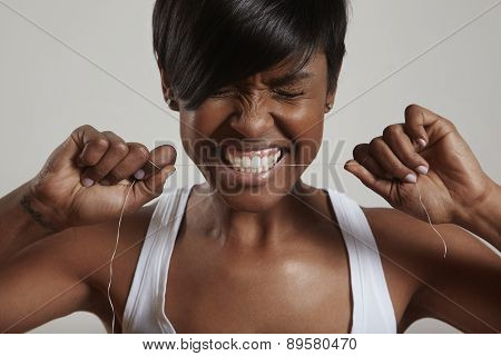 Woman Trying To Gnaw Through A Dental Floss