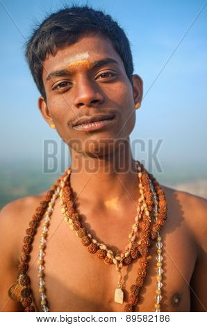 KAMALAPURAM, INDIA - 03 FEBRUARY: Indian pilgrim with religious necklaces and painted face on hilltop