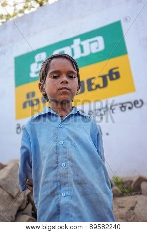 KAMALAPURAM, INDIA - 02 FEBRUARY 2015: Indian boy on street next to a market close to Hampi