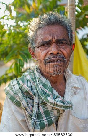 HAMPI, INDIA - 31 JANUARY 2015: Indian elderly man with checked scarf