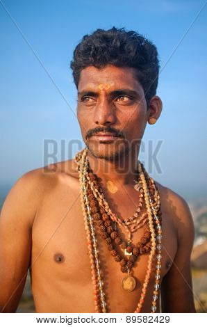 KAMALAPURAM, INDIA - 03 FEBRUARY: Indian pilgrim with religious necklaces and bindi on hilltop