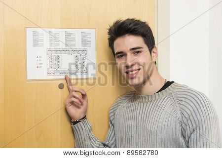 Young man in hotel pointing at floorplan
