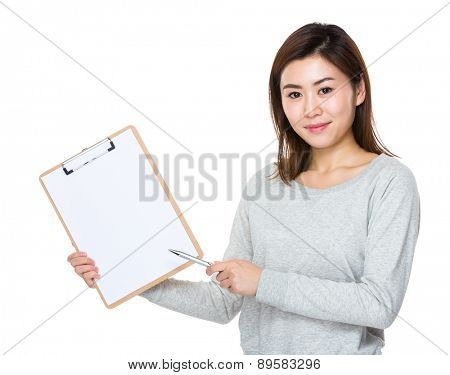 Woman with pen point to clipboard