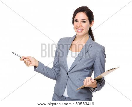 Businesswoman hold with clipboard and pen up