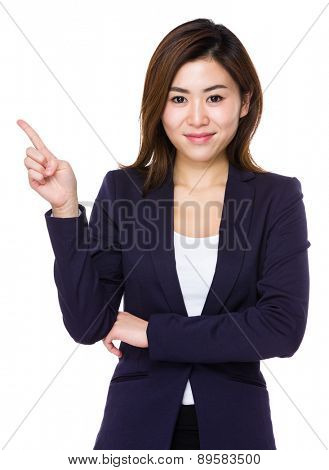 Young businesswoman with finger point up