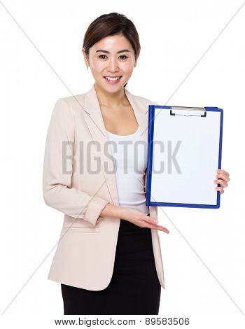 Businesswoman show with blank page of clipboard