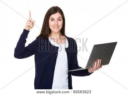 Woman use of laptop and finger pointing up