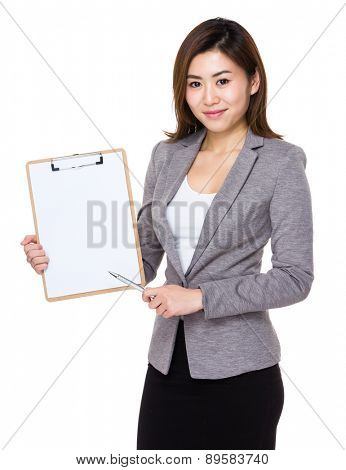 Businesswoman pen point to clipboard