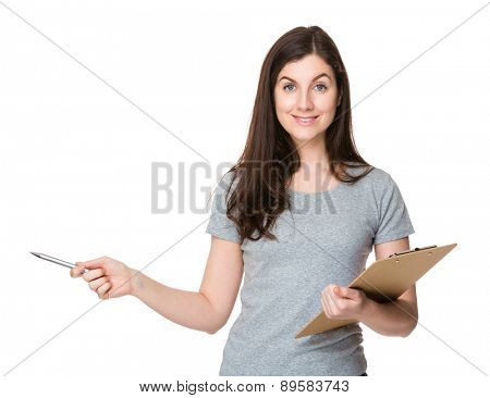 Brunette woman hold with clipboard and pen point up