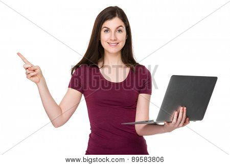 Caucasian woman use of laptop computer and finger up