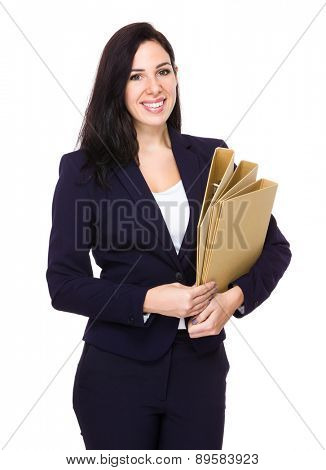 Brunette Businesswoman hold with folder