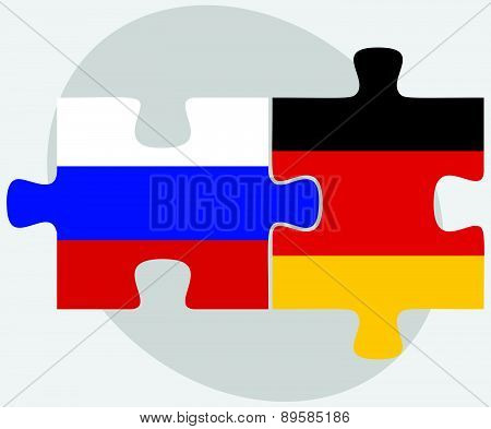 Russian Federation And Germany Flags In Puzzle