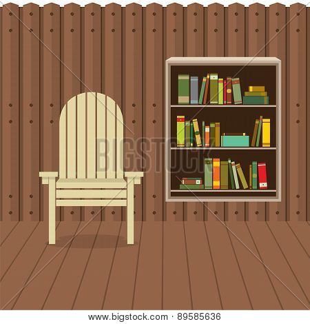 Empty Chair On Wood Wall And Ground With Bookcase Beside.
