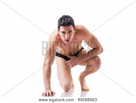 Handsome guy ready for a sprint isolated in white