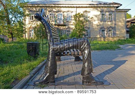 Unusual bench with legs in shoes, hands and eyes. Irkutsk