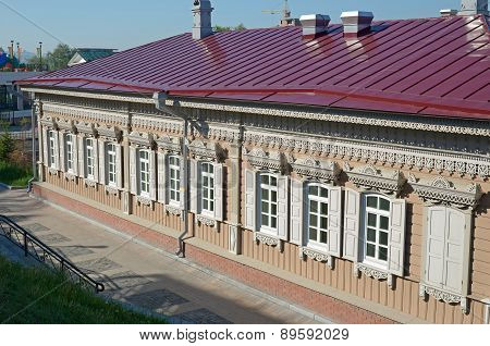 Wooden house with a white lace carving. Irkutsk