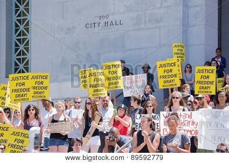 Group Of People Holding Signs