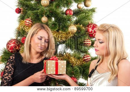 Beautiful blond smiling women with gift box