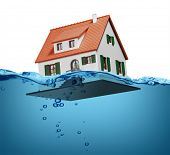 stock photo of flood-lights  - Toy house sinking underwater on a white background showing flooding concept - JPG