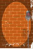 picture of spotlight  - Red brick wall with microphone and spotlight - JPG