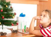 picture of letters to santa claus  - little girl writes a letter to Santa Claus - JPG