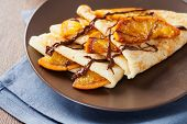 stock photo of crepes  - Crepes Suzette - thin pancakes with orange sauce ** Note: Shallow depth of field - JPG