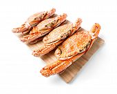 picture of cooked blue crab  - Steamed flower crab served on wooden chopping board - JPG