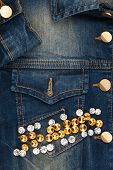 stock photo of denim jeans  - Word jeans made of rhinestones on denim jacket as background - JPG
