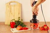 picture of blender  - Hands of cook are going to shred red pepper in a blender - JPG