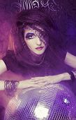 image of witch ball  - Young woman with artisric visage posing with disco - JPG
