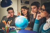 foto of geography  - Four beautiful students of Geography learning with globe and thinking - JPG