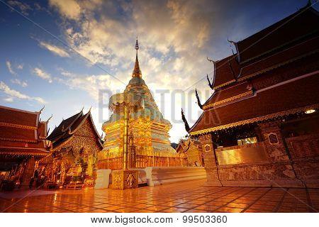 he golden pagoda in dramatic twilight sky of Wat Phrathat Doi Suthep