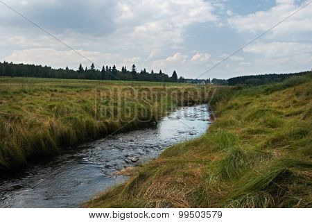 creek is state border between Czech Republic and Germany in Krusne hory mountais