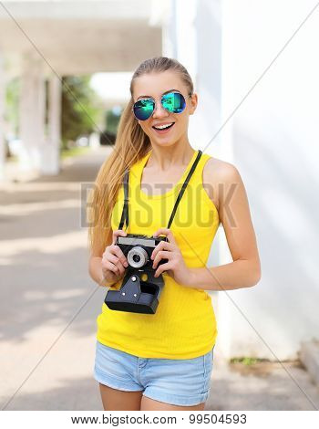 Portrait Of Happy Smiling Pretty Cool Girl In Sunglasses With Retro Vintage Camera Having Fun Outdoo