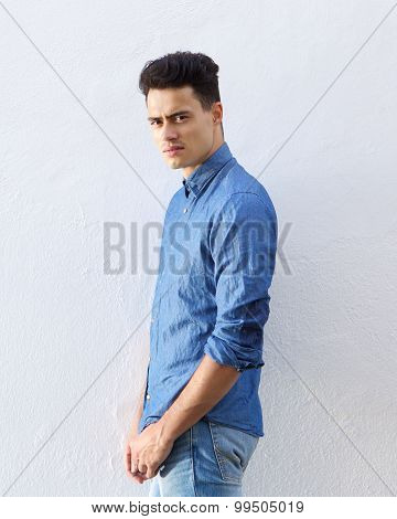 Handsome Young Man In Denim Blue Shirt Staring