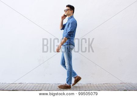 Handsome Young Man Walking And Talking On Cell Phone
