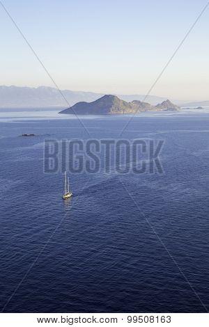 Aerial View Of A Lonely Sailboat Sailing Through The Calm Aegean Sea