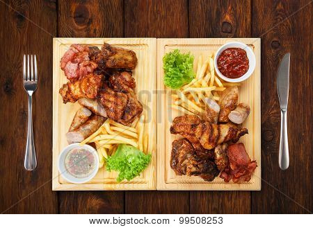 Restaurant Food Isolated - Grilled Meat Assortment Served On Wooden Board