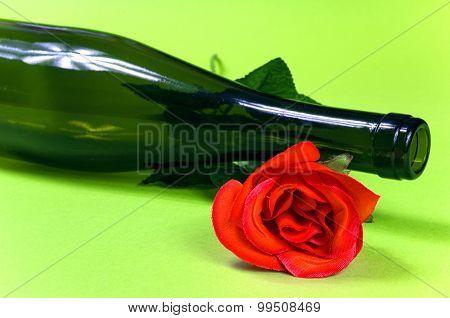 Empty Dark Wine Bottle With Red Rose
