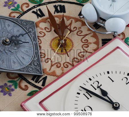 Various Clocks On Midnight Or Midday