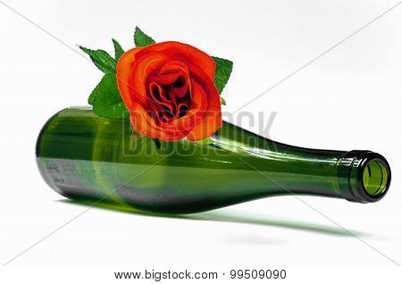 Empty Dark Wine Bottle Witk Red Rose