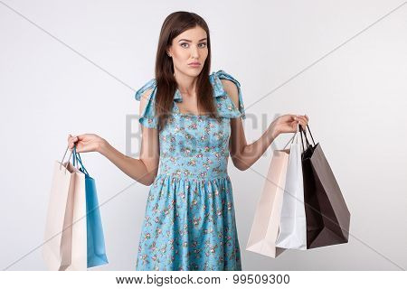 Pretty young styled girl is going shopping
