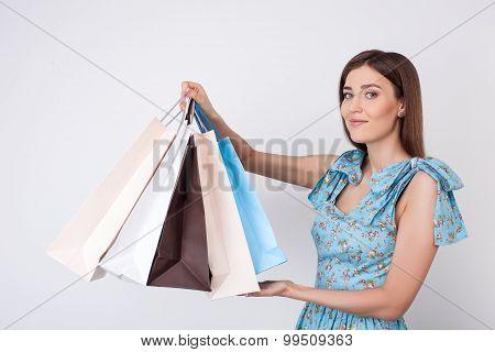 Beautiful young girl is going shopping for fun
