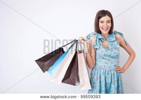Beautiful young woman in pretty dress is shopping
