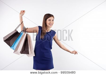 Attractive young woman is going shopping with joy