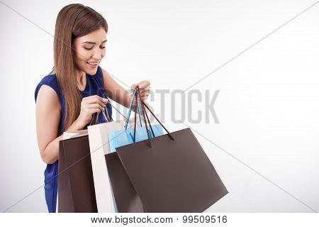 Beautiful young woman is going shopping with fun