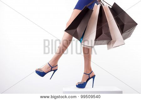 Pretty young girl is going shopping with joy