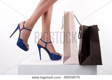 Cheerful sexy young woman loves going shopping