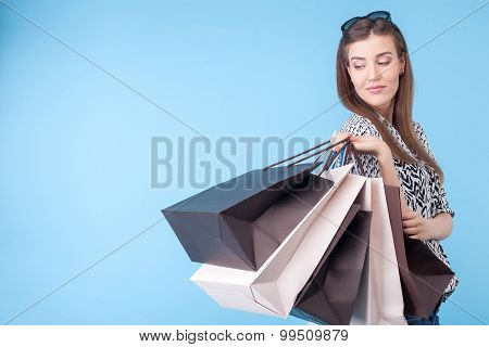 Beautiful young woman is going shopping with joy