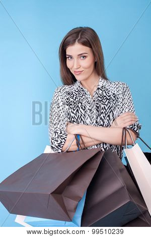 Attractive young woman is ready to buy everything